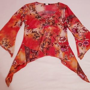 CAN'T MISS Orange blouse.